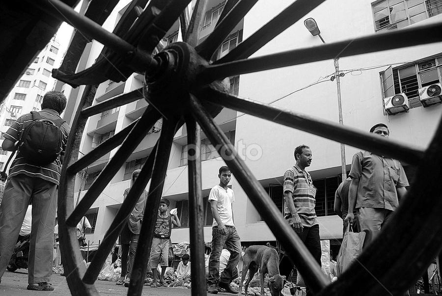 THE WHEEL OF LIFE by ASIT KUMAR GHATAK - City,  Street & Park  Street Scenes ( wheel )