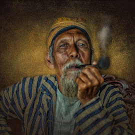 Oldmen and his pipe by Indrawan Ekomurtomo - People Portraits of Men