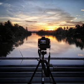 Capturing sun by Umar Aziz - Artistic Objects Technology Objects ( reflection, nature, waterscape, sunset, camera, sunrise, golden hour )