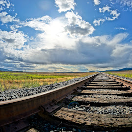 Call of the Rails by Barbara Brock - Transportation Railway Tracks ( beautiful skies, fish-eye train tracks, railway, cloudy skies, railroad tracks. train tracks, empty tracks )