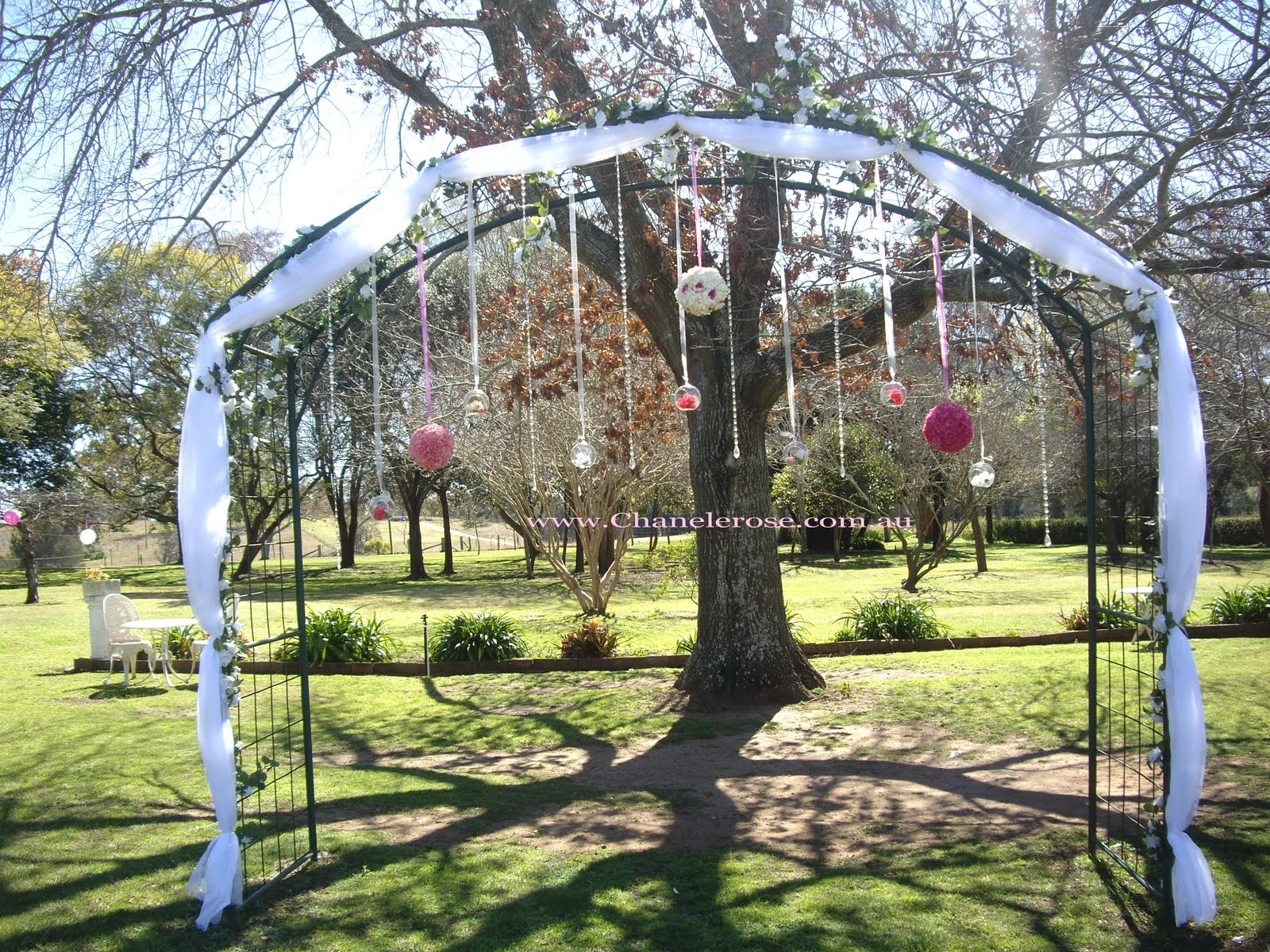 Outdoor Wedding Reception Tent decorated wedding arches
