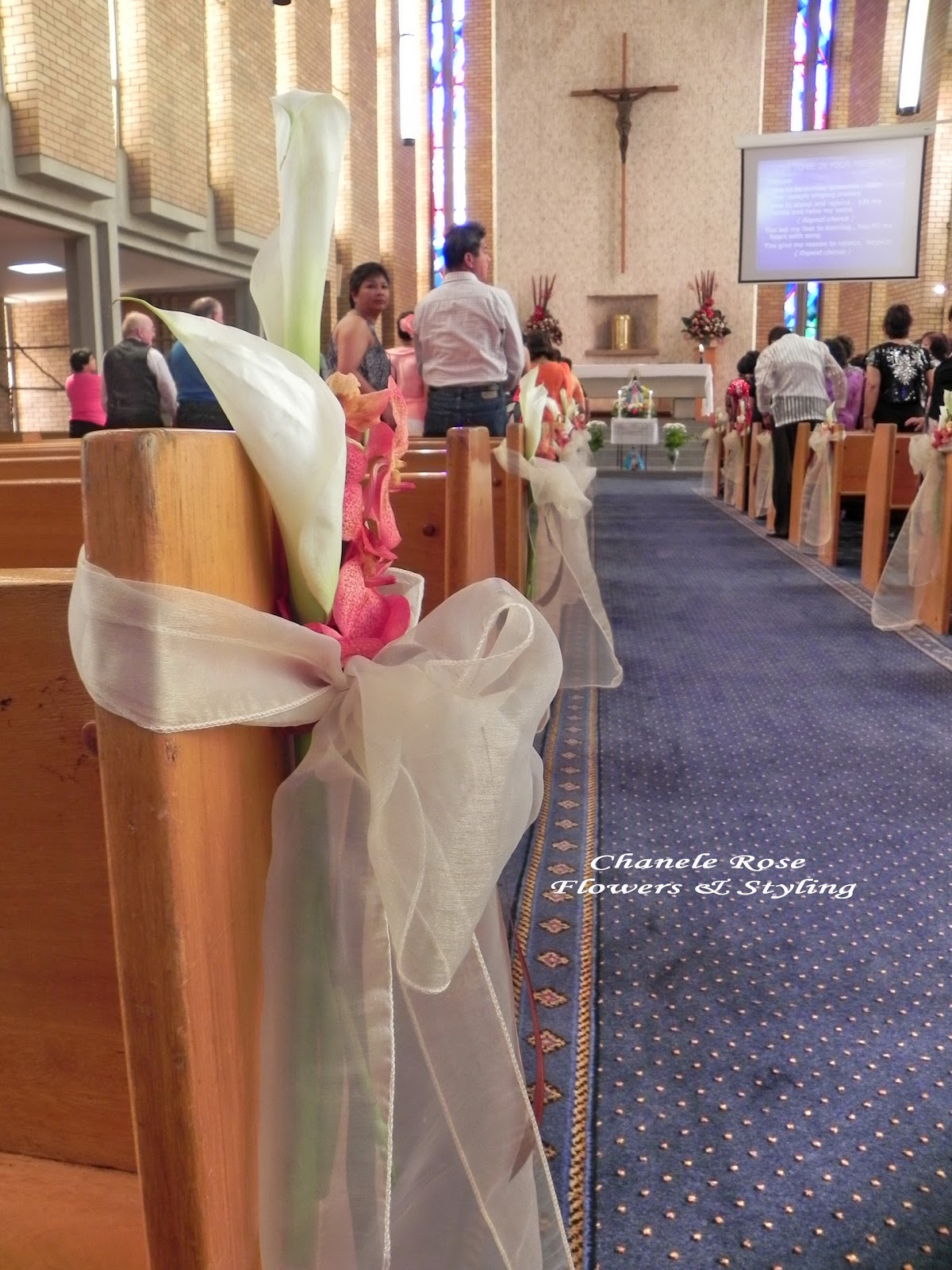 wedding pew bows church