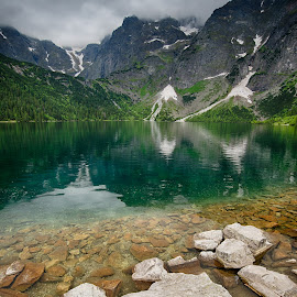 Morskie Oko lake, Poland by Péter Mocsonoky - Landscapes Mountains & Hills ( morskie oko, calm, water, clouds, mountains, nature, snow, lake, tranquility, rocks, hiking, poland )