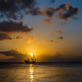 Cayman Sunset by Oleksiy Ohurtsov - Landscapes Sunsets & Sunrises ( clouds, water, landmark, skyline, sky, ship, sunset, summer, sunshine, sunrise, landscapes, landscape, sun, hope, island,  )