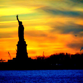 Colorful Sunset at Statue of Liberty by Naveed Hassan - Buildings & Architecture Statues & Monuments
