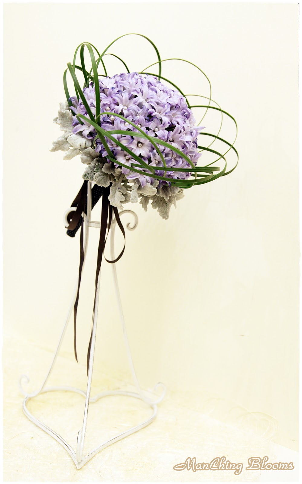 A mauve /blue wedding bouquet