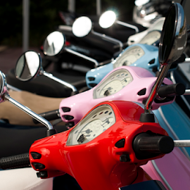 A line of mopeds/scooters by Deyan Georgiev - Transportation Automobiles ( ride, cycles, old, detail, motorbike, wheel, vehicle, street, retro, road, transportation, yellow, travel, parked, city, exposed, bike, style, vespa, transport, motor, moto, motorcycle, scooter, classic, closeup, shiny, cycle, vintage, speed, wheels, headlight, sport, moped, front, fun, row, tire, sale, many, urban, exposition, new, powered, blue, revival, restored, sidewalk )