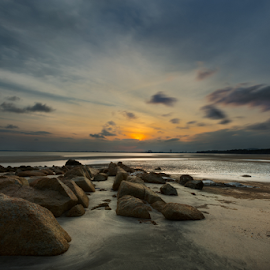 Sunset view of Kuantan Beach, Malaysia by Stanley Loong - Landscapes Sunsets & Sunrises ( blue sky, warm, sunset, kuantan, warmth, malaysia, seaside, yellow, beach, rocks )