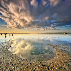 Odd by Hendri Suhandi - Landscapes Cloud Formations ( clouds, bali, sand, tuban, indonesia, reflections, beach )