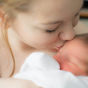 Babies first kiss by Mom by Darrin Halstead - People Family ( love, lovable, kiss, kissing, mother, baby girl, loving, baby, newborn,  )