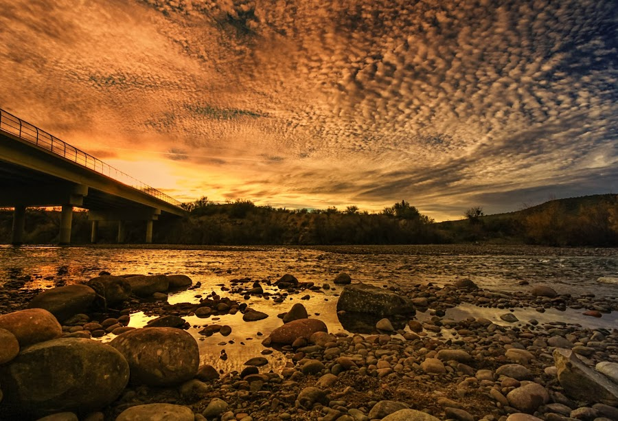 Lead On by Deb Bulger - Landscapes Sunsets & Sunrises ( clouds, orange, dramatic, bridge, waterscapes, landscapes, rocks, skies, river,  )