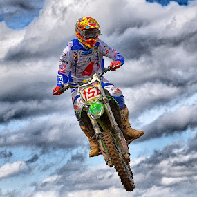 Sidejump by Marco Bertamé - Sports & Fitness Motorsports ( clouds, speed, green, number, yellow, race, jump, noise, red, 151, sky, motocross, blue, grey, high )