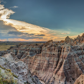 Badlands Sunset by Craig Pifer - Landscapes Mountains & Hills ( clouds, hills, badlands national park, national park, mountains, sky, sunset, south dakota, landscape, badlands, sun )