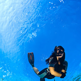 Diving by Rico Besserdich - Sports & Fitness Watersports ( aquatic, blue, underwater, woman, underwater photography, sea, ocean, rico besserdich, diving, swimming )