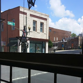 A view from inside the Kress Building looking out at the streets of Asheville N.C. Photojournalist/Photographer James Harold Bullman by James Bullman - Buildings & Architecture Public & Historical