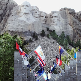 An Aisle of State Flags Honoring Presidents by Eric Michaels - Buildings & Architecture Statues & Monuments ( george washington, teddy roosevelt, flags, lincoln, mount rushmore, afternoon, sunny, the states, jefferson, south dakota, crowd, people )