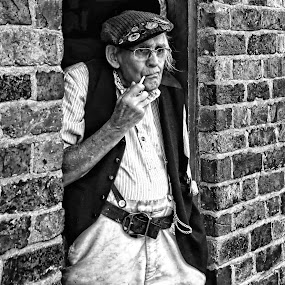having a break by Kathleen Devai - Black & White Street & Candid ( vintage, man, pipe, hat )