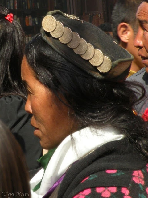 Sherpa woman wearing coin decorated hat