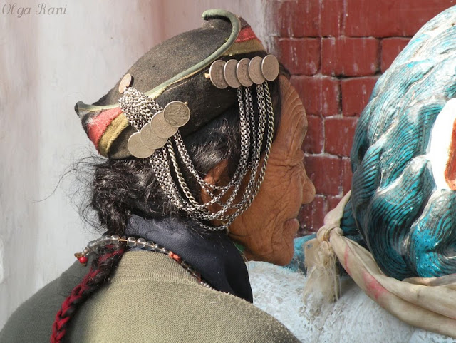 Sherpa woman in coins decorated hat