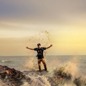 a man with water splash by Mohammad Khairizal Afendy - People Street & Candids ( person, full body, sunset, beautiful, landscape, rural, closeup, man )