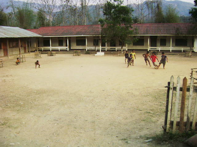 Children in Luang Prabang playing football in school