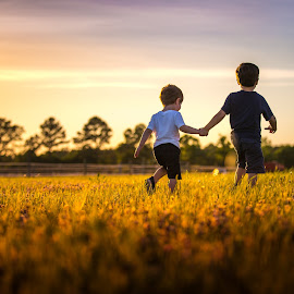 Best Buds by Mike DeMicco - Babies & Children Children Candids ( friends, sweet, sunset, best buds, boys, friendship, pals, kids, childhood, cute, light, holding hands )