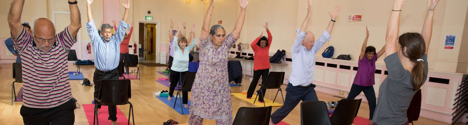 Carers enjoying a yoga class with Jodi