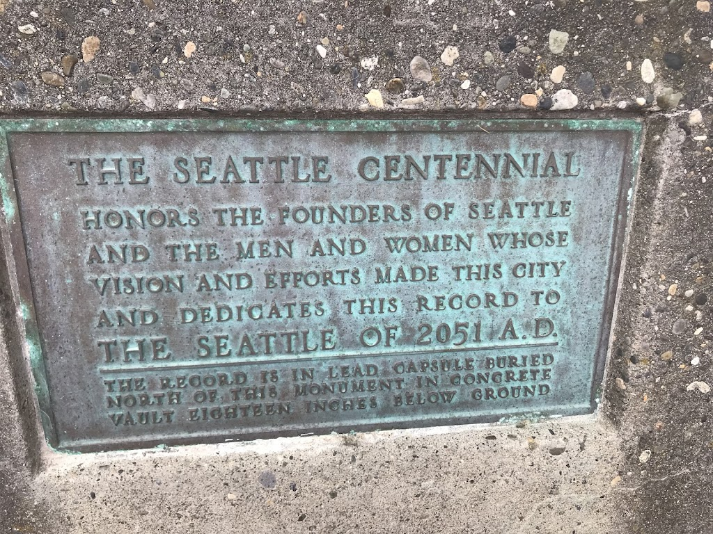THE SEATTLE CENTENNIAL HONORS THE FOUNDERS OF SEATTLE AND THE MEN AND WOMEN WHOSE VISION AND EFFORTS MADE THIS CITY AND DEDICATES THIS RECORD TO THE SEATTLE OF 2051 A.D. THE RECORD IS IN LEAD CAPSULE ...