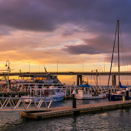 Boats at Sunset by Keith Walmsley - Buildings & Architecture Bridges & Suspended Structures ( victoria, coast, sunset, australia, boats, clouds, bridge, water, landscape )