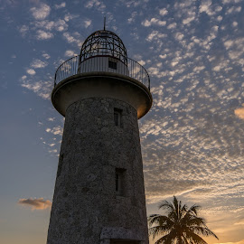 Boca Chita Lighthouse at Sunset by Stephanie Snow - Buildings & Architecture Other Exteriors ( water, palm tree, florida, sunset, lighthouse )