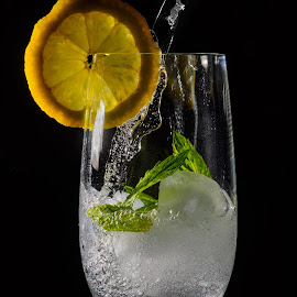 Refreshing Drink by Andreas Huppert - Food & Drink Alcohol & Drinks ( black background, water, refreshing, sparkling, ice, drink, mint, glass, icecube, lemon )