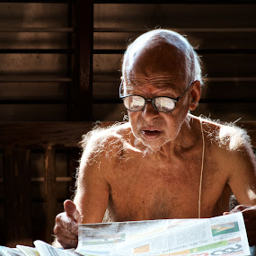 Newspaper reader by Prashanth UC - People Portraits of Men