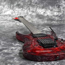 red seven-stringed electric guitar  on white-gray background-2.jpg
