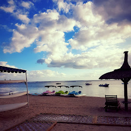 So Sofitel by Hayley Moortele - Transportation Boats ( #hotels, #pedalboats, #clouds, #sofitel, #beaches, #sea, #sky, #sunset, #comoyrs )