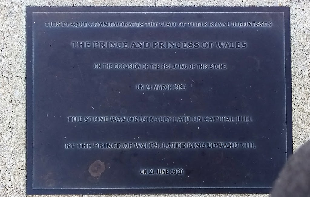 Plaque reads: 'This plaque commemorates the visit of their Royal Highnesses The Prince and Princess of Wales On the occasion of the re-laying of this stone on 24 March 1988 The stone was originally ...