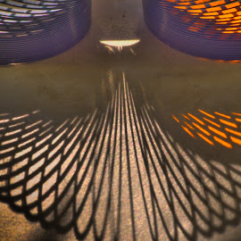 Slinking Along by Jerry Kambeitz - Artistic Objects Toys ( slinky, orange, toy, light, shadows )