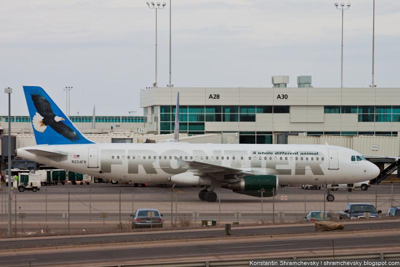 USA Colorado Denver International Airport Frontier Airlines Airbus A320-214 N204FR Freedom, the Bald Eagle США Колорадо Денвер Международный Аэропорт Фронтир Эйрлайнс Аэробус Эйрбас А320-214 Фридом Свобода Белоголовый Орлан Хвост Самолёта