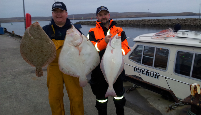 Charlie with two nice Turbot & Halibut