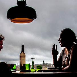 listen carefully by Staffan Håkansson - People Couples ( two, gossip, sky, stockholm, lamp, bottle )