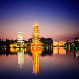 Twin Pagodas by Indrawaty Arifin - City,  Street & Park  City Parks ( reflection, park, pagoda, night )
