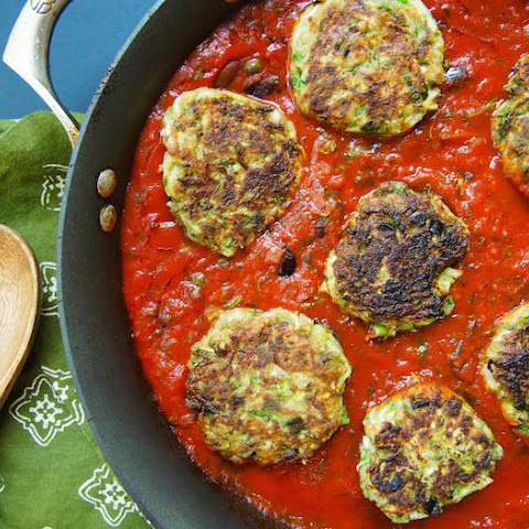 Zucchini Fritters in Tomato Olive Sauce