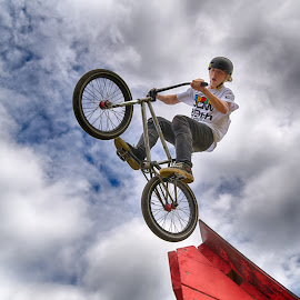 Take-Off by Marco Bertamé - Sports & Fitness Other Sports ( takeoff, wheel, ¨clouds, speed, dow, helmet, take-off, stunt, jump, ramp, two, flying, red, sky, blue, cloudy, grey, air, high )