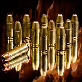 ammo bowling by Dale Pausinga - Digital Art Things ( reflection, ammunition, brass, gold, ammo, bullets,  )