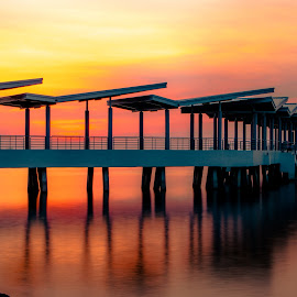 Jetty on Fire by Ynon Francisco - Buildings & Architecture Bridges & Suspended Structures ( calm, warm, smooth, sunset, sea, long exposure, tranquility, jetty, philippines, esplanade, golden hour )