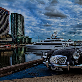 Traveling in Style by Peter Cannon - City,  Street & Park  Vistas ( water, canon, clouds, automobiles, melbourne, waterscape, yacht, sea, ocean, transportation, landscape, docklands, sky, blue, mg )