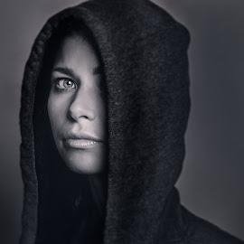 Marte by Bendik Møller - Black & White Portraits & People ( headshot, model, fashion, monochrome, black and white, dark background, young girl, close up, close, blackandwhite, girl, female, dramatic, dark, head, mono, hood, eye )
