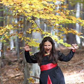 In the forest by Sergey Sokolov - People Street & Candids ( forest, woman, woods, yellow, girl, portrait, trees, colors, canon, mountain, fall, leaves, 100mm, wood, autumn, colorful,  )