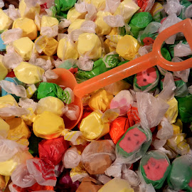 Taffy and Shovel by Kathy Rose Willis - Food & Drink Candy & Dessert ( orange, taffy, sweet, colorful, candy, shovel )