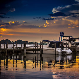 Sunset Prevails by John Witt - Landscapes Sunsets & Sunrises ( wild sunset, dramatic clouds, sunset, sunset reflection, marina,  )
