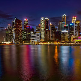 Singapore by Peter Schoeman - City,  Street & Park  Skylines ( reflextions, water, skyline, night, singapore )